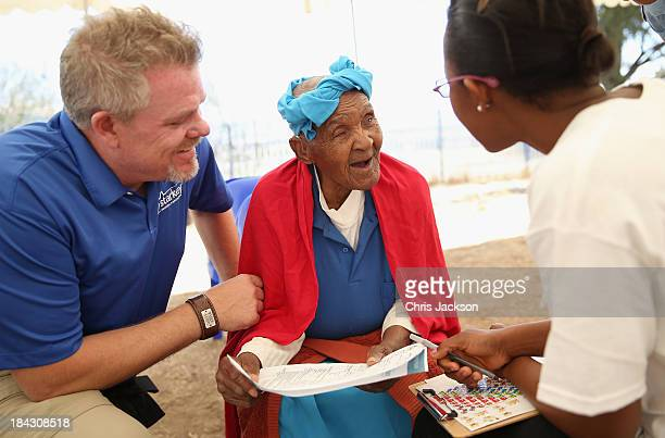 Brady Forseth of the Starkey Foundation fits hearing aids at Lesotho Cooperative College on October 10 2013 in Maseru Lesotho Prince Harry's Charity...