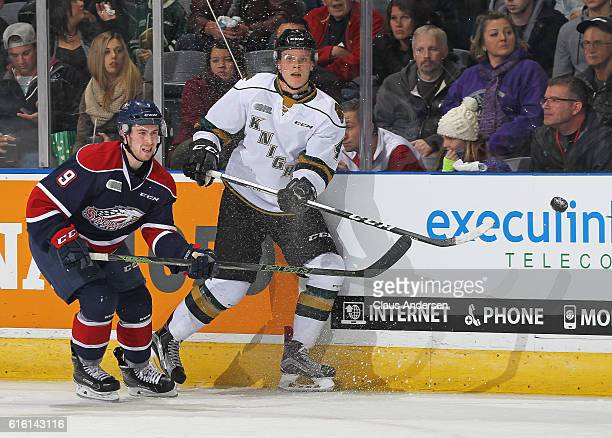 Brady Gilmour of the Saginaw Spirit skates against Olli Juolevi of the London Knights during an OHL game at Budweiser Gardens on October 21 2016 in...