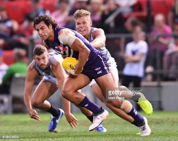 Brady Grey of Fremantle under pressure from Dan Houston of Port Adelaide during the AFLX match between Port Adelaide and Fremantle at Hindmarsh...