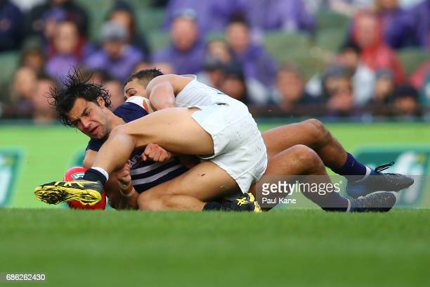 Brady Grey of the Dockers gets tackled by Ed Curnow of the Blues during the round nine AFL match between the Fremantle Dockers and the Carlton Blues...