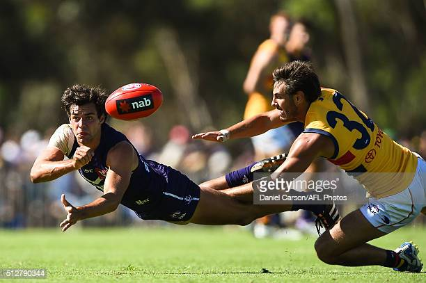 Brady Grey of the Dockers handballs during the 2016 NAB Challenge match between Fremantle Dockers and the Adelaide Crows at Sounness Park Mount...