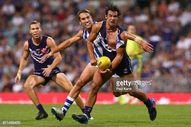 Brady Grey of the Dockers handballs during the round five AFL match between the Fremantle Dockers and the North Melbourne Kangaroos at Domain Stadium...