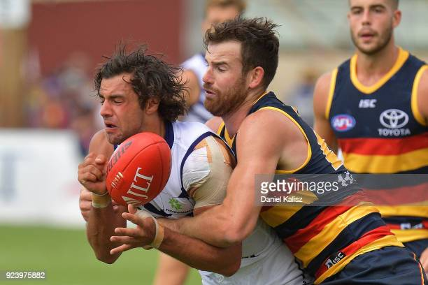 Brady Grey of the Dockers is tackled by Andy Otten of the Crows during the JLT Community Series AFL match between the Adelaide Crows and the...