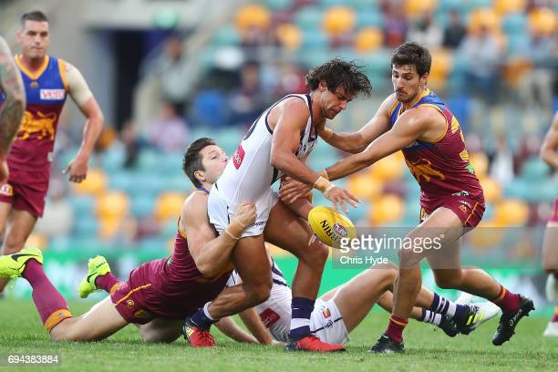 Brady Grey of the Dockers is tackled during the round 12 AFL match between the Brisbane Lions and the Fremantle Dockers at The Gabba on June 10 2017...