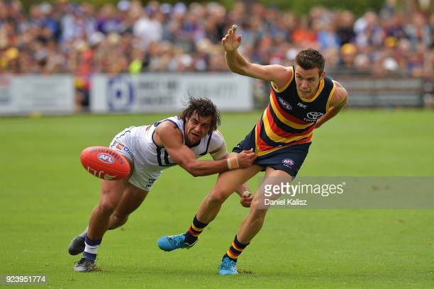 Brady Grey of the Dockers tackles Paul Seedsman of the Crows during the JLT Community Series AFL match between the Adelaide Crows and the Fremantle...