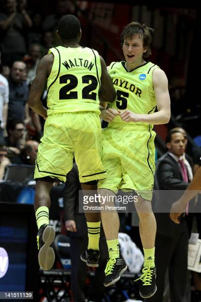 Brady Heslinp and A.J. Walton of the Baylor Bears show camaraderie in the second half of the game against the Colorado Buffaloes during the third...