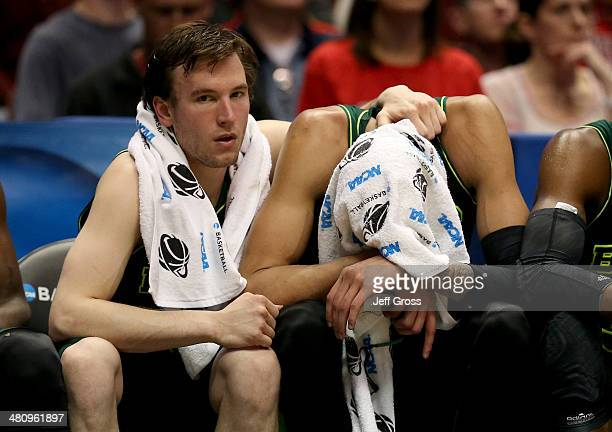 Brady Heslip and Isaiah Austin of the Baylor Bears sit on the bench late in the second half while taking on the Wisconsin Badgers during the regional...