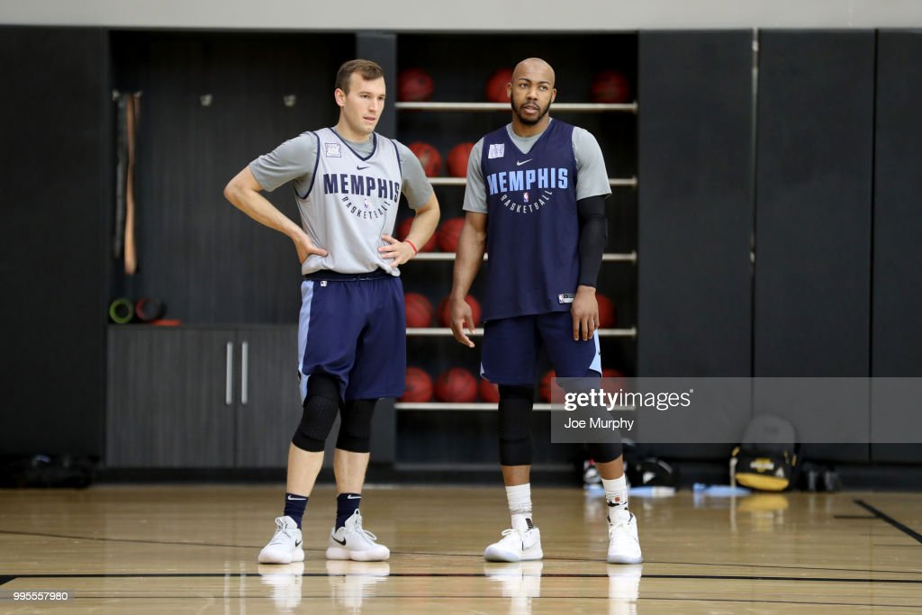 newest b04ab 29189 Brady Heslip and Jevon Carter of the Memphis Grizzlies look ...