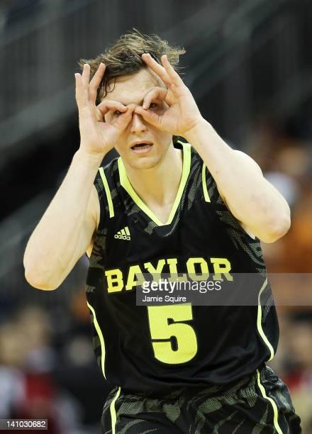 Brady Heslip of the Baylor Bears celebrates a three pointer in the second half against the Kansas Jayhawks during the semifinals of the 2012 Big 12...