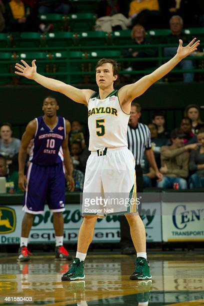 Brady Heslip of the Baylor Bears defends against the Northwestern State Demons on December 18 2013 at the Ferrell Center in Waco Texas
