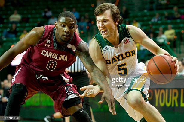 Brady Heslip of the Baylor Bears drives to the basket against Sindarius Thornwell the South Carolina Gamecocks on November 12 2013 at the Ferrell...