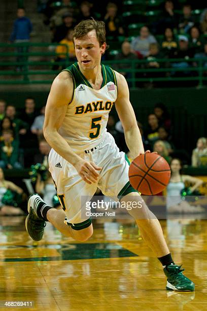 Brady Heslip of the Baylor Bears drives to the basket against the West Virginia Mountaineers on January 28 2014 at the Ferrell Center in Waco Texas