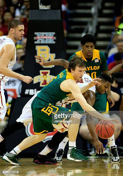 Brady Heslip of the Baylor Bears loses control of the ball as Melvin Ejim of the Iowa State Cyclones defends during the 2014 Big 12 Men's...