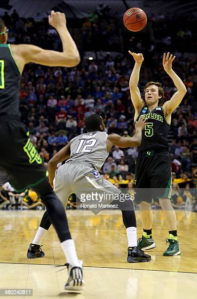 Brady Heslip of the Baylor Bears makes a pass as Jahenns Manigat of the Creighton Bluejays defends during the third round of the 2014 NCAA Men's...