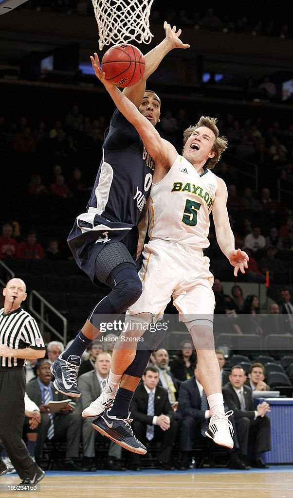 Brady Heslip #5 of the Baylor Bears puts up a basket past a defending Brandon Davies #0 of the Brigham Young Cougars in the first half during the 2013 NIT Championship - Semifinals at the Madison Square Garden on April 2, 2013 in New York City.