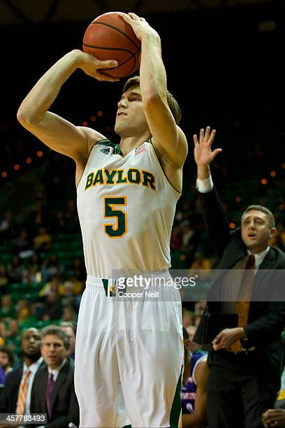 Brady Heslip of the Baylor Bears shoots a threepointer against the Northwestern State Demons on December 18 2013 at the Ferrell Center in Waco Texas