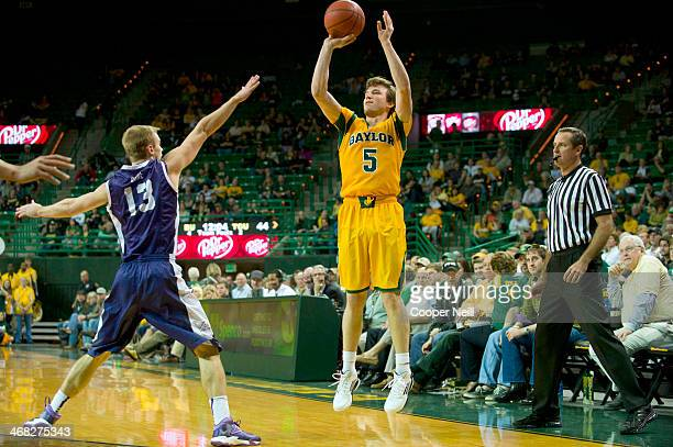 Brady Heslip of the Baylor Bears shoots a threepointer against the TCU Horned Frogs on January 11 2014 at the Ferrell Center in Waco Texas