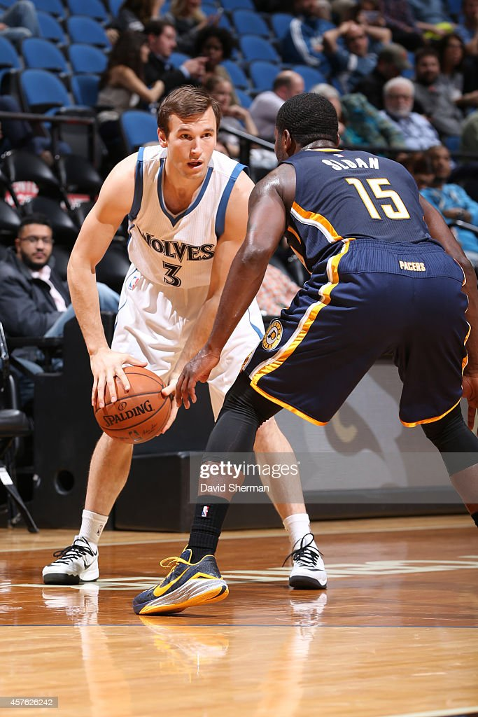 Brady Heslip #3 of the Minnesota Timberwolves handles the ball against Donald Sloan #15 of the Indiana Pacers on October 21, 2014 at Target Center in Minneapolis, Minnesota.