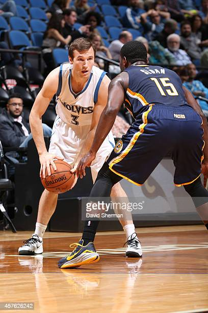Brady Heslip of the Minnesota Timberwolves handles the ball against Donald Sloan of the Indiana Pacers on October 21 2014 at Target Center in...