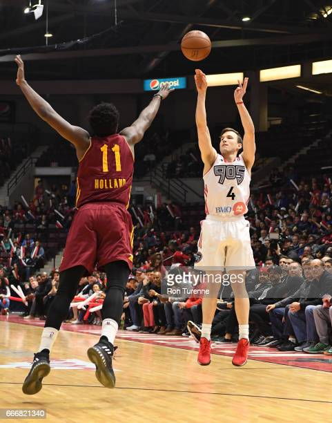 Brady Heslip of the Raptors 905 shoots the ball over John Holland of the Canton Charge at the Hershey Centre on April 8 2017 in Mississauga Ontario...