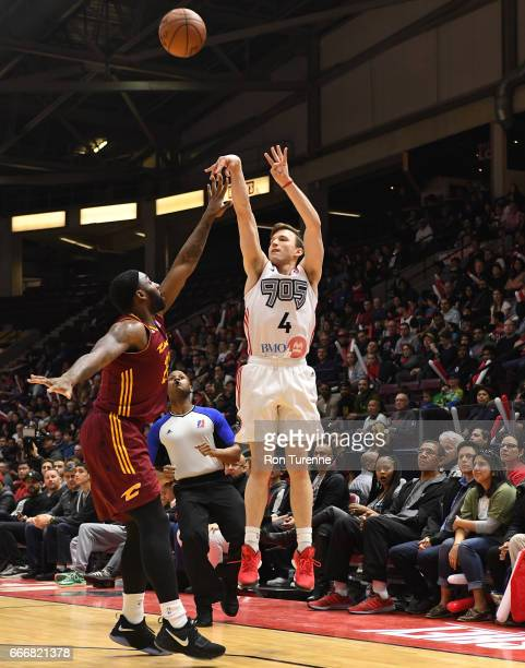 Brady Heslip of the Raptors 905 shoots the ball over Roosevelt Jones of the Canton Charge at the Hershey Centre on April 8 2017 in Mississauga...