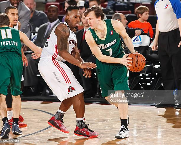 Brady Heslip of the Reno Bighorns defends the ball from Nick Covington of the Idaho Stampede during an NBA DLeague game on November 28 2014 at...