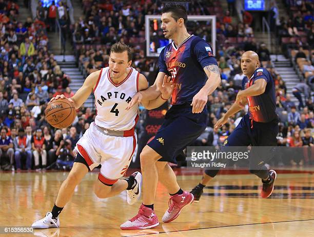 Brady Heslip of the Toronto Raptors dribbles the ball during a NBA preseason game against San Lorenzo de Almagro at Air Canada Centre on October 14...