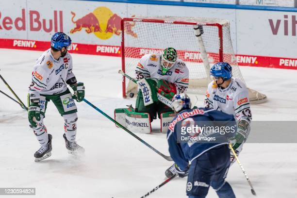 Brady Lamb of Augsburger Panther, goalkeeper Markus Keller of Augsburger Panther, Andrew MacWilliam of EHC Red Bull Muenchen and Steffen Toelzer of...