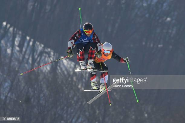 Brady Leman of Canada infront of Marc Bischofberger of Switzerland in the Freestyle Skiing Men's Ski Cross Big Final on day 12 of the PyeongChang...