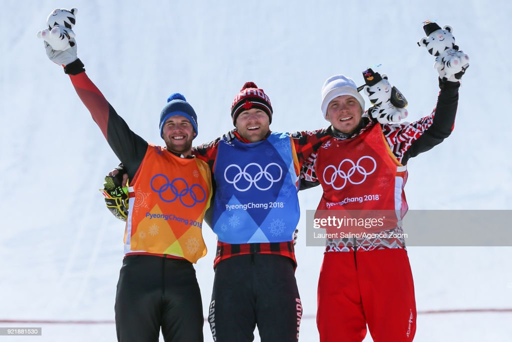 Brady Leman of Canada takes 1st place, Marc Bischofberger of Switzerland takes 2nd place, Sergey Ridzik of Russia takes 3rd place during the Freestyle Skiing Men's Finals Ski Cross at Pheonix Snow Park on February 21, 2018 in Pyeongchang-gun, South Korea.