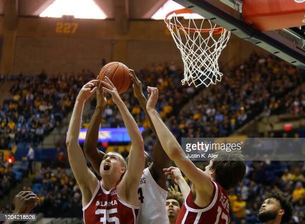 Brady Manek of the Oklahoma Sooners battles for a rebound against the West Virginia Mountaineers at the WVU Coliseum on February 29 2020 in...
