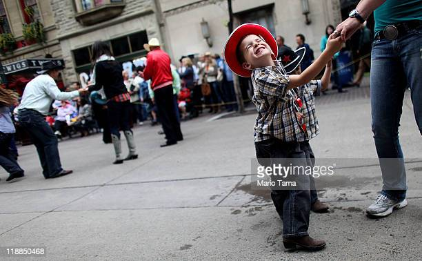 Brady Margaritis square dances during the Calgary Stampede on July 11 2011 in Calgary Alberta Canada The ten day event drawing over one million...