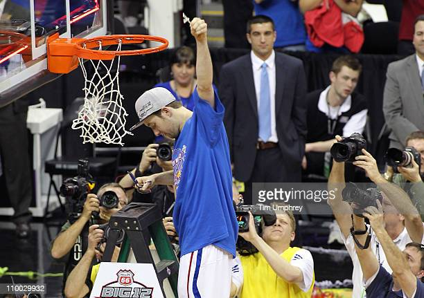 Brady Morningstar of the Kansas Jayhawks celebrates after defeating the Texas Longhorns in the championship game of the 2011 Phillips 66 Big 12 Men's...