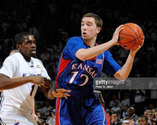 Brady Morningstar of the Kansas Jayhawks looks to make a pass against pressure from Fred Brown of the Kansas State Wildcats on February 14, 2009 at...