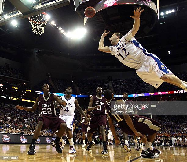 Brady Morningstar of the Kansas Jayhawks shoots during the semifinals of the 2010 Phillips 66 Big 12 Men's Basketball Tournament against the Texas...