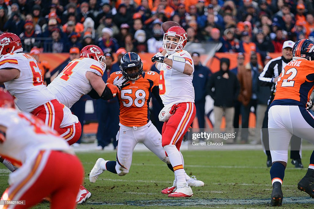Brady Quinn #9 of the Kansas City Chiefs throws before Von Miller #58 of the Denver Broncos can get to him during the game at Sports Authority Field at Mile High on December 30, 2012 in Denver, Colorado.