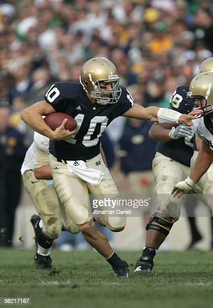 Brady Quinn of the Notre Dame Fighting Irish carries the ball during the game against the Navy Midshipman on November 12 2005 at Notre Dame Stadium...