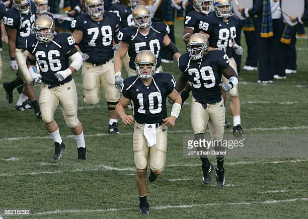 Brady Quinn of the Notre Dame Fighting Irish runs onto the field during the game against the Navy Midshipman on November 12 2005 at Notre Dame...