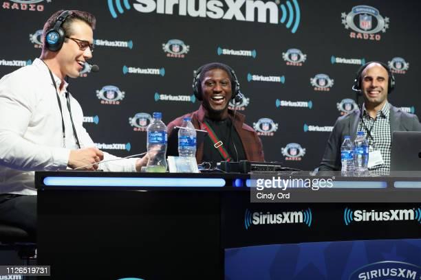Brady Quinn Xavier Rhodes and Bruce Gradkowski attend SiriusXM at Super Bowl LIII Radio Row on January 31 2019 in Atlanta Georgia