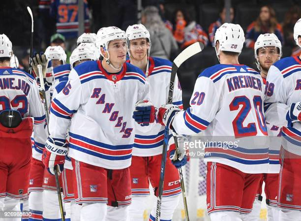 Brady Skjei and Chris Kreider of the New York Rangers celebrate after winning the game against the Edmonton Oilers on March 3 2018 at Rogers Place in...