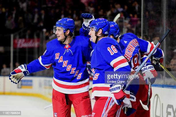 Brady Skjei and Ryan Strome of the New York Rangers celebrate a second period goal with teammates during their game against the Arizona Coyotes at...