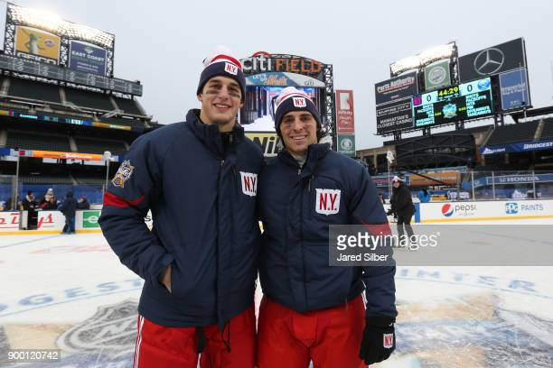 Brady Skjei and Vinni Lettieri of the New York Rangers pose for a photo during family skate after practice for the 2018 Bridgestone NHL Winter...