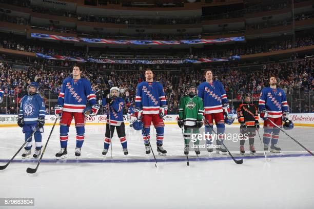 Brady Skjei Michael Grabner JT Miller and Mats Zuccarello of the New York Rangers greet Junior Ranger players on the blue line for the national...