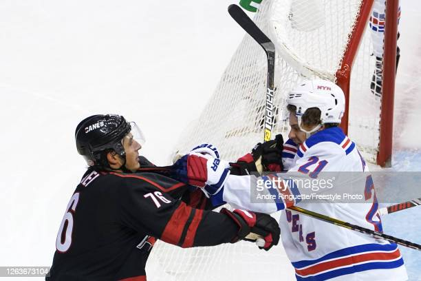 Brady Skjei of the Carolina Hurricanes and Brett Howden of the New York Rangers fight in Game Two of the Eastern Conference Qualification Round prior...