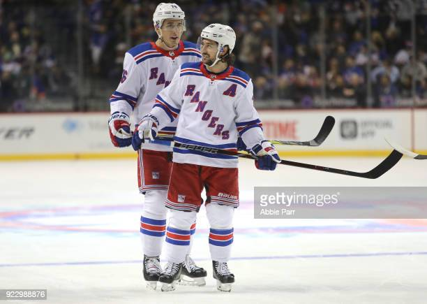 Brady Skjei of the New York Rangers and Mats Zuccarello of the New York Rangers have a conversation in the first period against the New York...
