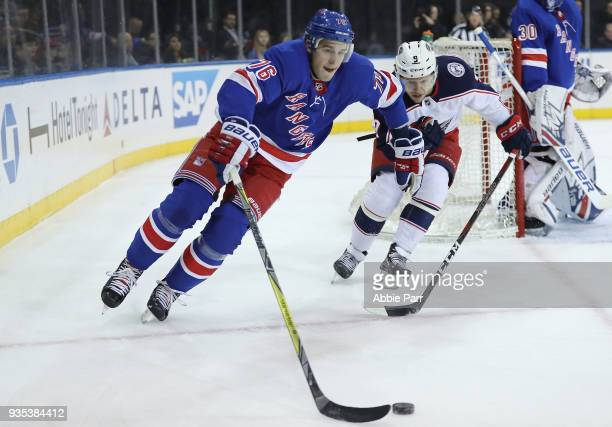 Brady Skjei of the New York Rangers chases the puck against Artemi Panarin of the Columbus Blue Jackets in the first period during their game at...