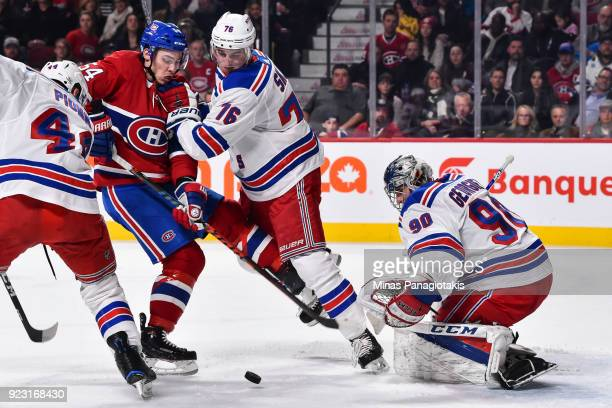 Brady Skjei of the New York Rangers defends against Charles Hudon of the Montreal Canadiens as goaltender Alexandar Georgiev watches the puck in his...