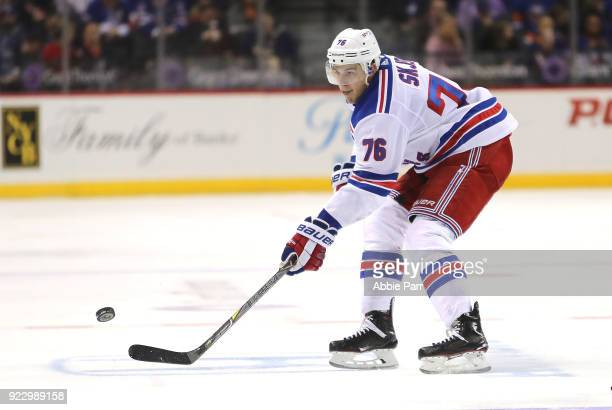Brady Skjei of the New York Rangers reaches for the puck in the third period against the New York Islanders during their game at Barclays Center on...