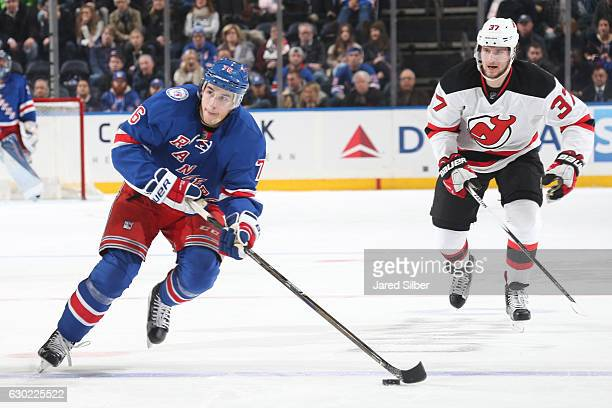 Brady Skjei of the New York Rangers skates with the puck against the New Jersey Devils at Madison Square Garden on December 18 2016 in New York City