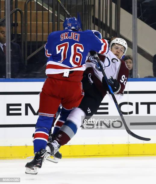 Brady Skjei of the New York Rangers steps into Gabriel Landeskog of the Colorado Avalanche during the first period at Madison Square Garden on...